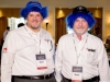 Two-Men-At-Corporate-Conference-Wearing-Blue-Wigs