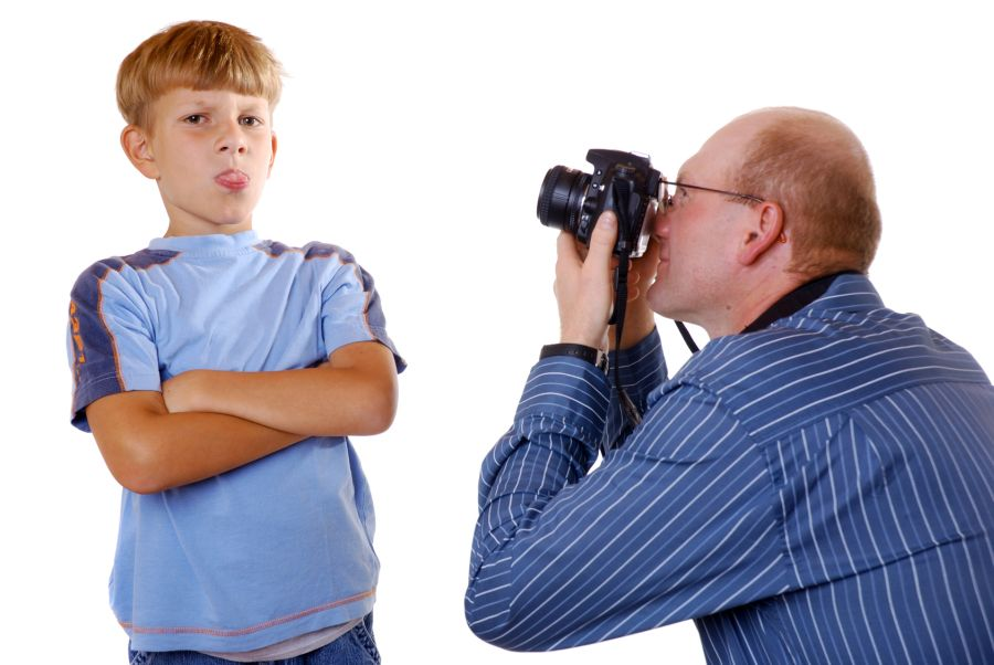 Photographer and Kid with tongue out