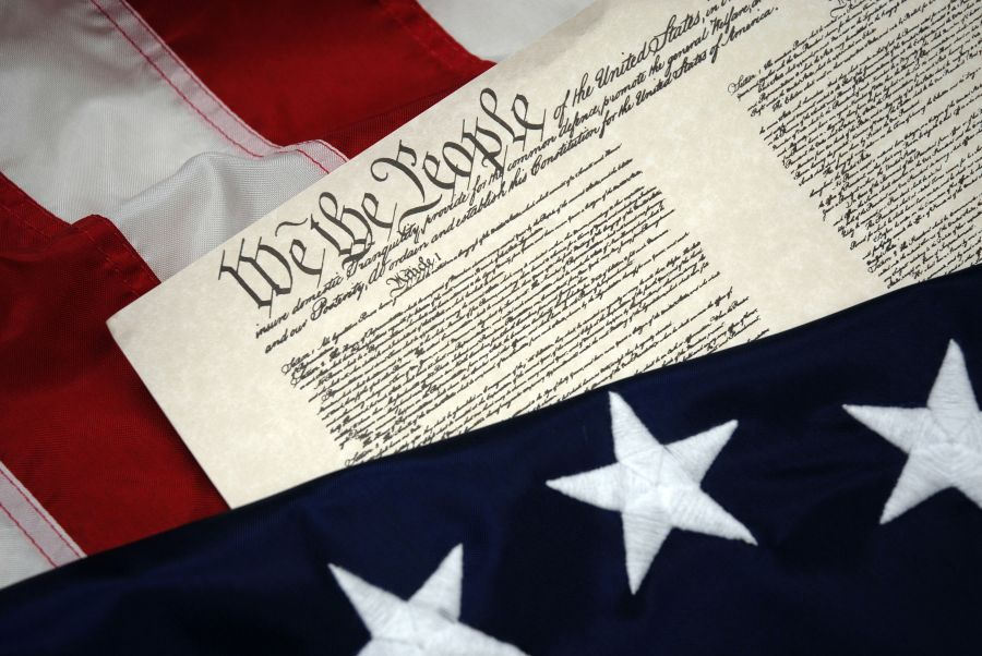 We The People - U.S. Constitution document and flag