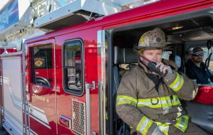 Two Firemen Inside Firetruck One Using Radio Image by DWPPC.jpg