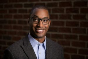 Casual Male Headshot On Brick Creative Lighting Raleigh NC.jpg
