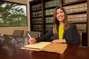 Commercial Photography of Attorney In Conference Room With Books Raleigh.jpg