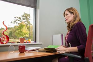 Female Executive at Table Looking Out Window.jpg