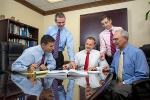 Five Male Executives Around Conference Table.jpg